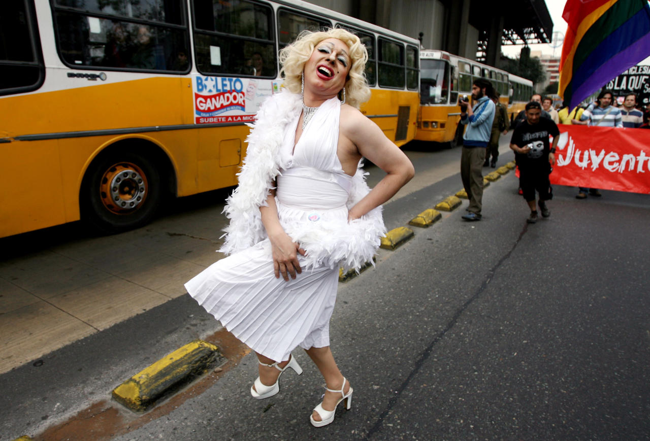A gay rights activist dressed as Marilyn Monroe performances during a Gay Pride parade  in Santiago Photographer:   (C)Ivan Alvarado