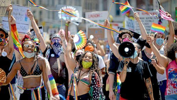 PHOTO: Marchers are seen smiling and waving during the Queer Liberation March for Black Lives & Against Police Brutality on June 28, 2020 in New York City. (Alexi Rosenfeld/Getty Images, FILE)