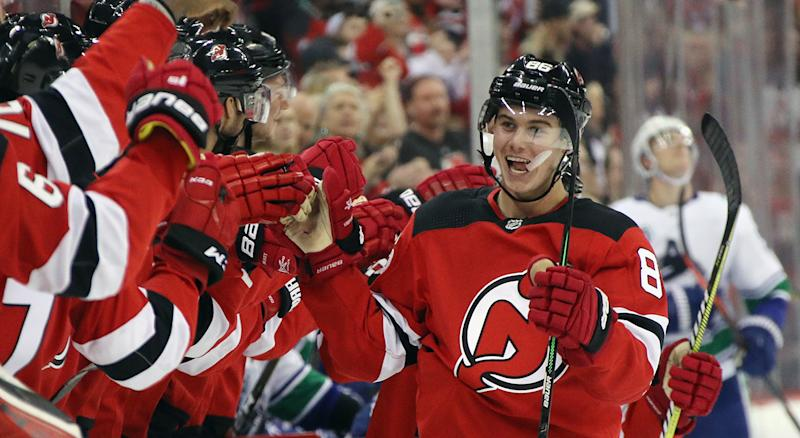NEWARK, NEW JERSEY - OCTOBER 19: Jack Hughes #86 of the New Jersey Devils celebrates his first NHL goal as he scores at 14:08 of the first period on the power-play against the Vancouver Canucks at the Prudential Center on October 19, 2019 in Newark, New Jersey. (Photo by Bruce Bennett/Getty Images)