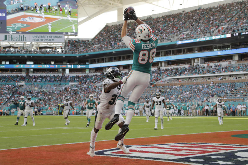 Miami Dolphins tight end Mike Gesicki (88) catches a touchdown pass over Philadelphia Eagles cornerback Jalen Mills (31), during the second half at an NFL football game, Sunday, Dec. 1, 2019, in Miami Gardens, Fla. (AP Photo/Lynne Sladky)