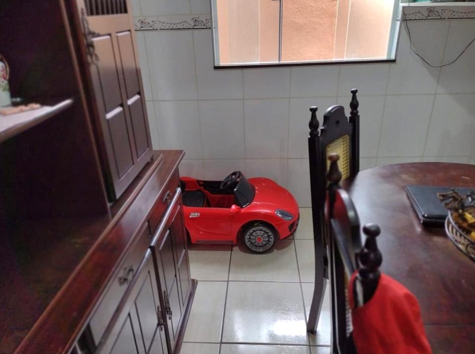 The snake was hiding in the wheel of the toy car. Source: Newsflash/Australscope