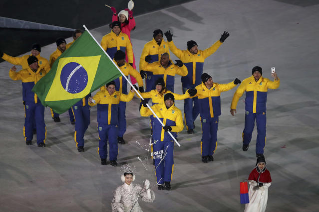 <p>Edson Bindilatti carries the flag of Brazil during the opening ceremony of the 2018 Winter Olympics in Pyeongchang, South Korea, Friday, Feb. 9, 2018. (Sean Haffey/Pool Photo via AP) </p>