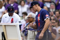 National League's Freddie Freeman, of the Atlanta Braves, left, and American League's Aaron Judge, of the New York Yankees, right, escort the wife of the late Hank Aaron, Billye Aaron to the field prior to the MLB All-Star baseball game, Tuesday, July 13, 2021, in Denver. (AP Photo/Jack Dempsey)