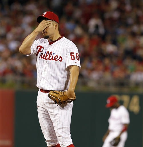 Philadelphia Phillies starting pitcher Joe Blanton, left, wipes his face in the fifth inning of an interleague baseball game with the Boston Red Sox, Saturday, May 19, 2012, in Philadelphia. The Red Sox won 7-5. (AP Photo/Alex Brandon)