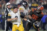 FILE - In this Thursday, Nov. 14, 2019, file photo, Cleveland Browns defensive end Myles Garrett (95) reacts after swinging a helmet at Pittsburgh Steelers quarterback Mason Rudolph (2) in the fourth quarter of an NFL football game in Cleveland. The Browns (10-5) will make the postseason for the first time since 2002 with a win over the Steelers. Pittsburgh, which clinched the AFC North last week, is resting quarterback Ben Roethlisberger and will start Mason Rudolph, who has a history with Cleveland's Myles Garrett after an ugly helmet-swinging incident a year ago. (AP Photo/David Richard, File)