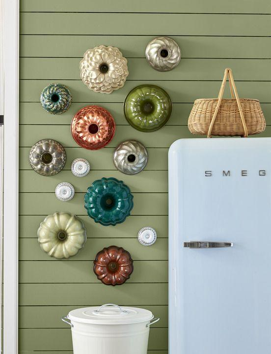 <p>A collection of colorful vintage Bundt pans in assorted shapes lends retro flair to a kitchen or pantry wall. Bonus: You can take 'em down and use them as needed. </p>
