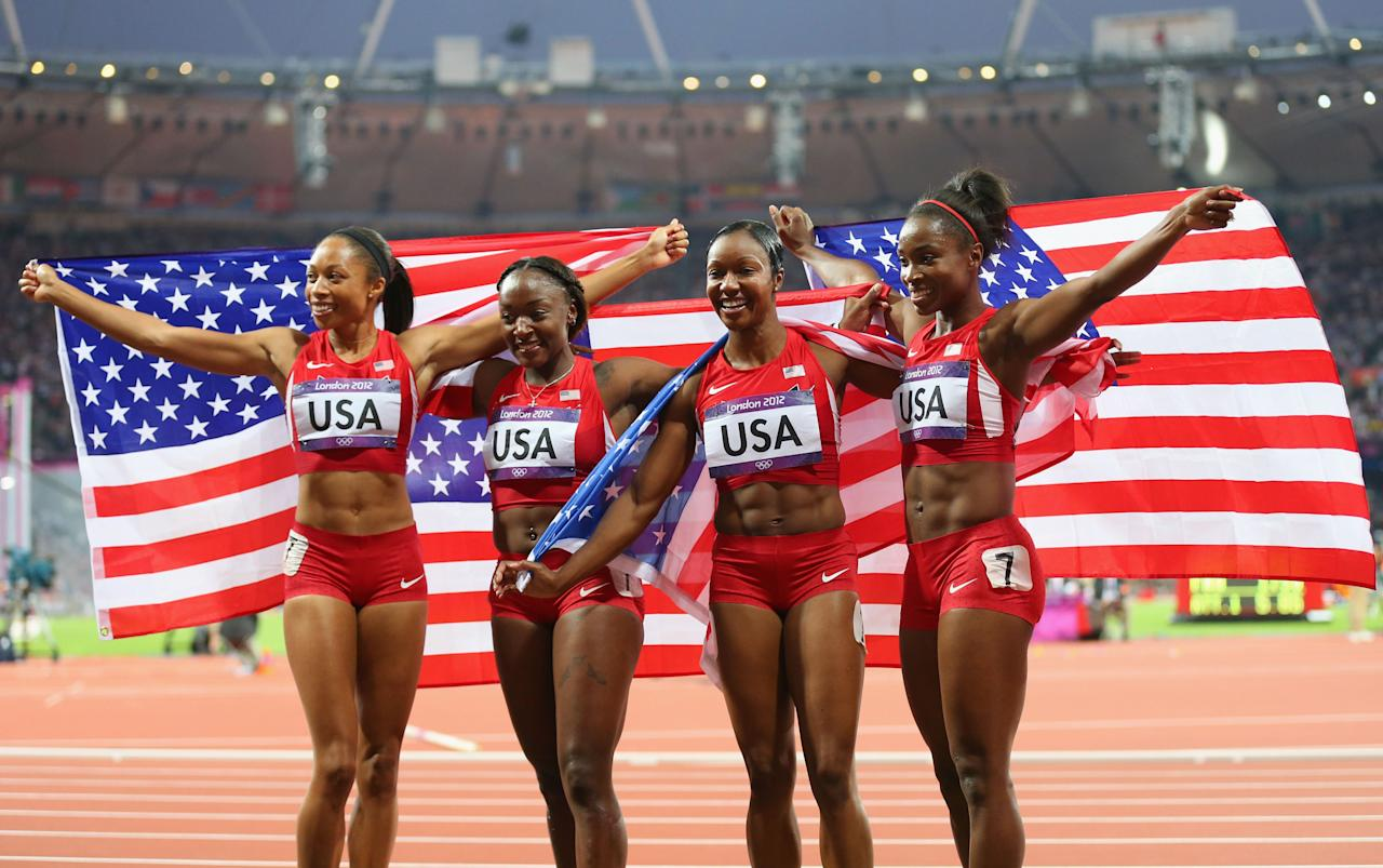 LONDON, ENGLAND - AUGUST 10:  Carmelita Jeter of the United States, Bianca Knight of the United States, Allyson Felix of the United States and Tianna Madison of the United States celebrate after winning gold and setting a new world record of 40.82  afterthe Women's 4 x 100m Relay Final on Day 14 of the London 2012 Olympic Games at Olympic Stadium on August 10, 2012 in London, England.  (Photo by Alex Livesey/Getty Images)