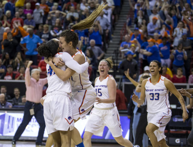Boise State forward A'Shanti Coleman (42) and guard Riley Lupfer (21) embrace in celebration after their 62-60 win over Nevada in an NCAA college basketball game in the championship of the Mountain West Conference tournament Friday, March 9, 2018, in Las Vegas. (AP Photo/L.E. Baskow)