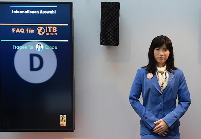 Dressed in a blue jacket with a neck scarf, ChihiraKanae is on her first visit to Europe where she is seeking potential employment for herself and her kind (AFP Photo/Tobias Schwarz                      )