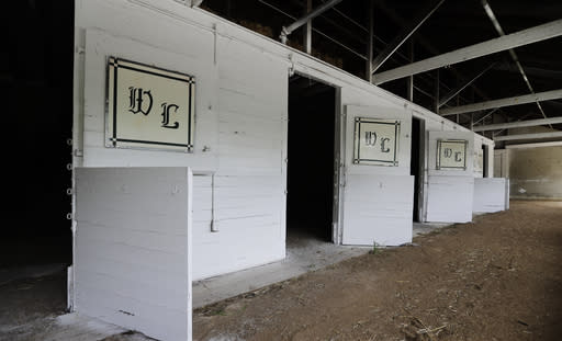 The training stable of D. Wayne Lukas sits empty at Churchill Downs, Wednesday, April 22, 2020, in Louisville, Ky. The Run For The Roses wasn't held on the first Saturday in May for the first time since 1945, and it remains to be seen whether the new date on Sept 5 will draw the same crowds and attention. (AP Photo/Darron Cummings)