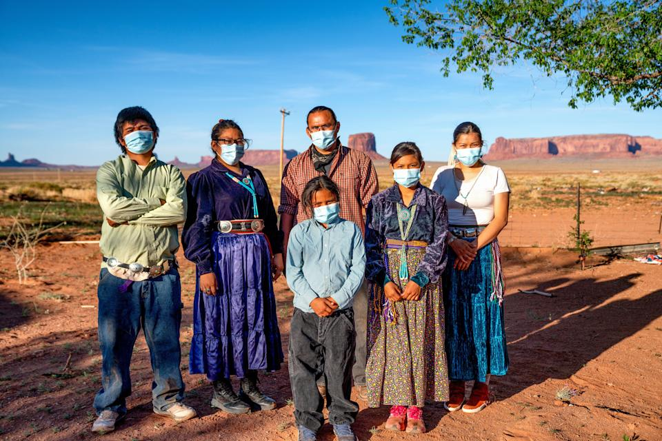 A Navajo family wears masks to protect against the spread of COVID-19 in Monument Valley, Arizona. (Photo: grandriver via Getty Images)