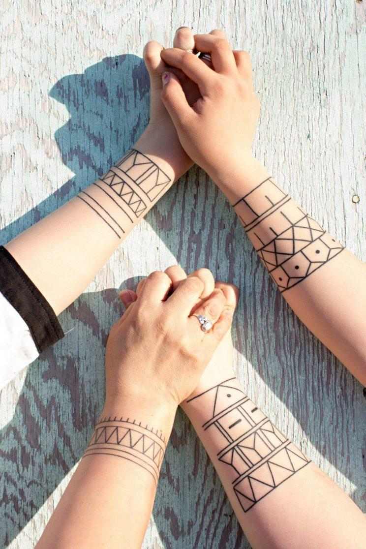 """<p>""""Inuit traditional tattoos have been lost for three to four generations (over a 100 years) in some communities, and during the project we tattooed a family of three generations,"""" Johnston said. Photo from Cora DeVos/Little Inuk Photography</p>"""