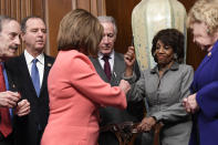 House Financial Services Committee Chairwoman Maxine Waters, D-Calif., second from right, reacts after getting a pen from House Speaker Nancy Pelosi of Calif., after she signed the resolution to transmit the two articles of impeachment against President Donald Trump to the Senate for trial on Capitol Hill in Washington, Wednesday, Jan. 15, 2020. The two articles of impeachment against Trump are for abuse of power and obstruction of Congress. Other looking on are, from left, House Foreign Affairs Committee Chairman Rep. Eliot Engel, D.-N.Y., House Intelligence Committee Chairman Adam Schiff, D-Calif., House Ways and Means Committee Chairman Rep. Richard Neal, D-Mass., and Rep. Zoe Lofgren, D-California. (AP Photo/Susan Walsh)