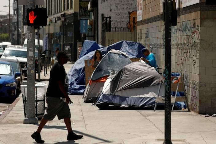 Tents and tarps erected by homeless people are shown along sidewalks and streets in the skid row area of downtown Los Angeles, California