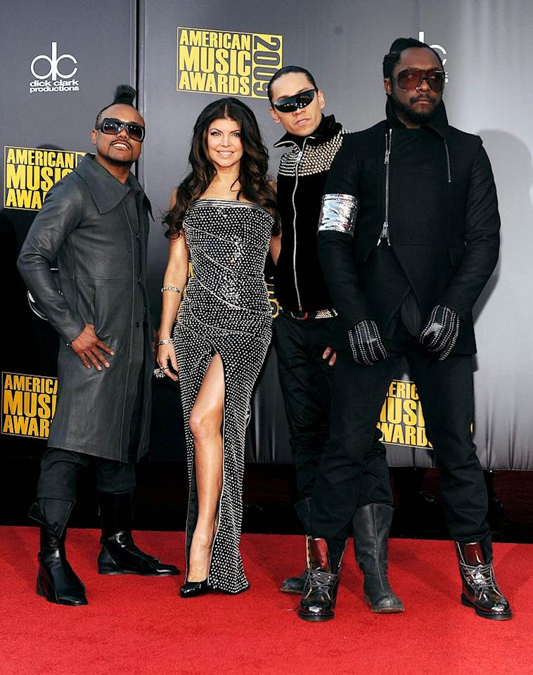 """Black Eyed Peas  Grade: A-  As usual, Fergie brought the glam in a studded gown, while her bandmates, apl.de.ap, Taboo, and will.i.am, did their best to create a cohesive look in black and silver getups. Frazer Harrison/AMA2009/<a href=""""http://www.gettyimages.com/"""" target=""""new"""">GettyImages.com</a> - November 22, 2009"""
