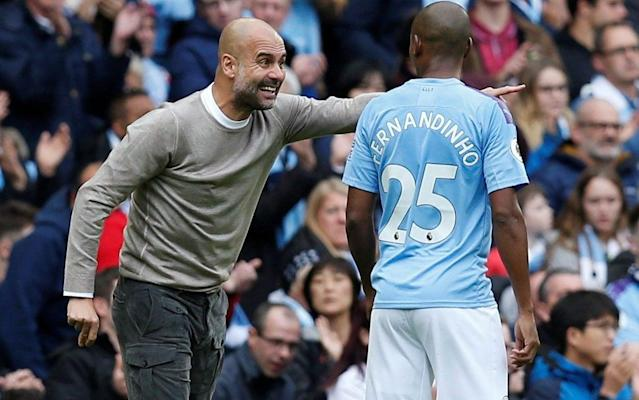 Pep Guardiola barks instructions at his players - REUTERS