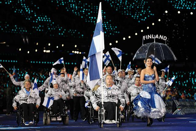 LONDON, ENGLAND - AUGUST 29: Athlete Leo-Pekka Tahti of Finaldn carries the flag during the Opening Ceremony of the London 2012 Paralympics at the Olympic Stadium on August 29, 2012 in London, England. (Photo by Dan Kitwood/Getty Images)