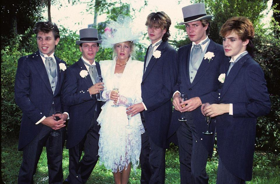 """<p>Recognize the groom and the groomsmen in this photo? That's right, it's the wedding of Andy Taylor of Duran Duran. The look is a bit more classic British than their usual style during this time period.</p><p><a href=""""http://www.goodhousekeeping.com/beauty/fashion/g3941/most-expensive-wedding-dresses/"""" rel=""""nofollow noopener"""" target=""""_blank"""" data-ylk=""""slk:9 of the most expensive wedding dresses »"""" class=""""link rapid-noclick-resp""""><em>9 of the most expensive wedding dresses »</em></a><br></p>"""