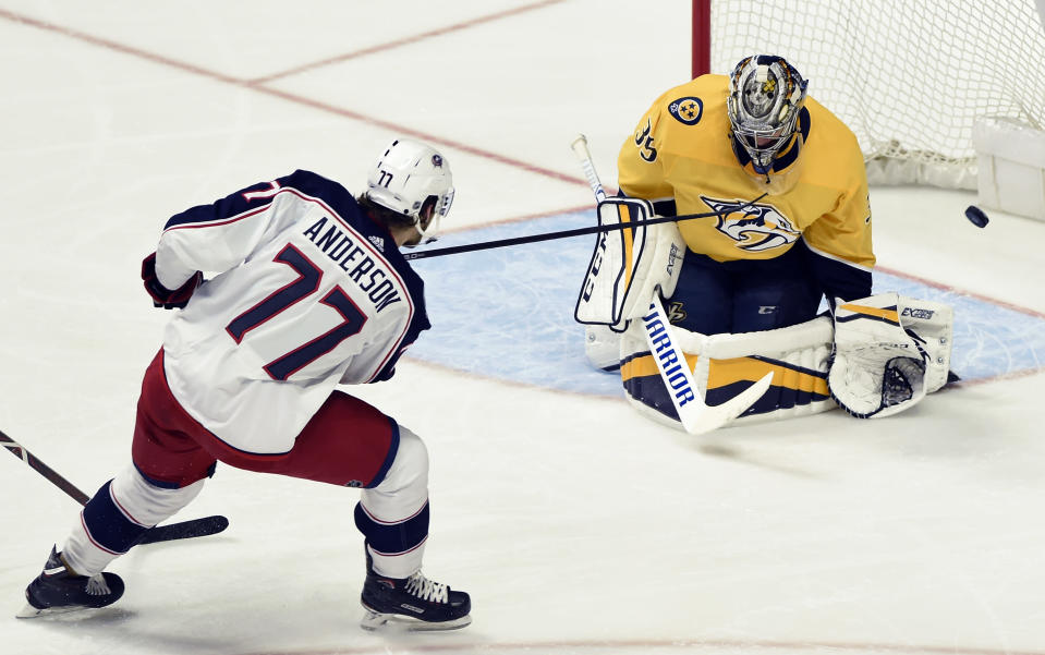 Columbus Blue Jackets right wing Josh Anderson (77) scores a goal against Nashville Predators goaltender Pekka Rinne (35), of Finland, during the second period of an NHL hockey game Saturday, April 7, 2018, in Nashville, Tenn. (AP Photo/Mark Zaleski)