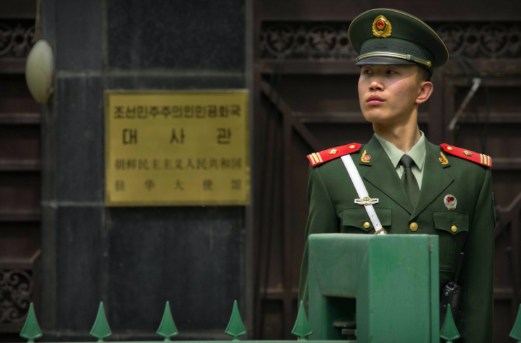 A Chinese policeman stands guard outside the North Korean Embassy in Beijing (Picture: Rex)