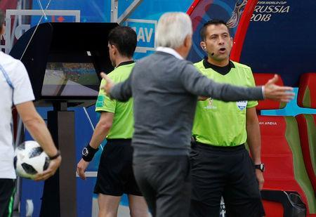 Soccer Football - World Cup - Group C - France vs Australia - Kazan Arena, Kazan, Russia - June 16, 2018 Referee Andres Cunha reviews a incident on VAR before awarding a penalty to France REUTERS/John Sibley