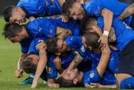 Italian players celebrate their second goal during the Euro 2020 soccer championship group A match between Italy and Switzerland at the Olympic stadium in Rome, Italy, Wednesday, June 16, 2021. (AP Photo/Alessandra Tarantino, Pool)