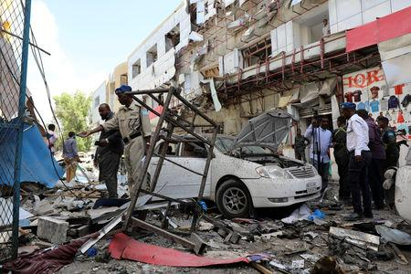 Somali security forces look at the scene of an explosion in Mogadishu, Somalia Fabruary 4, 2019. REUTERS/Feisal Omar