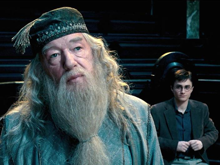 Michael Gambon as Albus Dumbledore and Daniel Radcliffe as Harry Potter.
