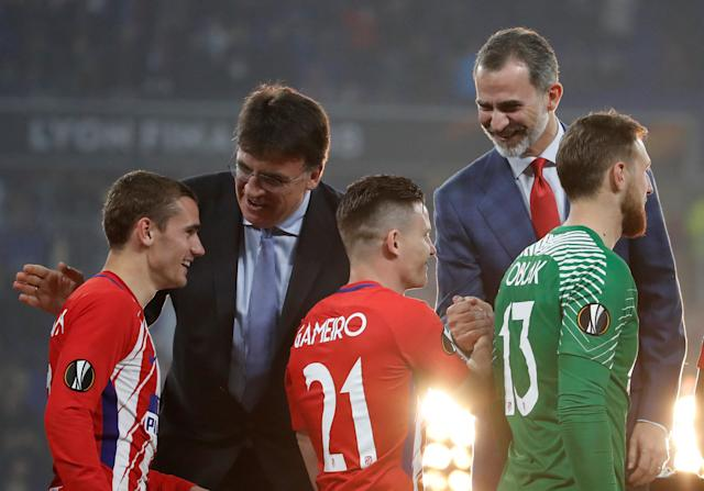Soccer Football - Europa League Final - Olympique de Marseille vs Atletico Madrid - Groupama Stadium, Lyon, France - May 16, 2018 Atletico Madrid's Antoine Griezmann, Kevin Gameiro and Jan Oblak receive their medals from Spain's King Felipe VI after winning the Europa League REUTERS/Christian Hartmann