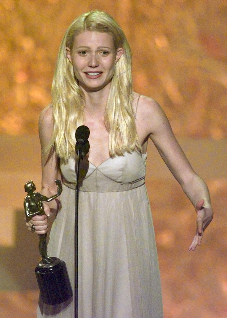 """Actress Gwyneth Paltrow accepts the award for """"Outstanding Performance by a Female Actor in a Leading Role"""" for her performance in """"Shakespeare in Love"""" during the Fifth Annual Screen Actors Guild Award show at the Shrine Auditorium in Los Angeles, Sunday, March 7, 1999. (AP Photo/ Michael Caufield)"""