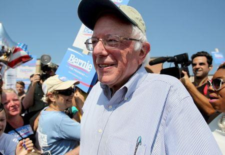 U.S. Democratic presidential candidate and U.S. Senator Bernie Sanders pauses to talk to the media before the start of the Milford Labor Day Parade in Milford, New Hampshire September 7, 2015. REUTERS/Mary Schwalm