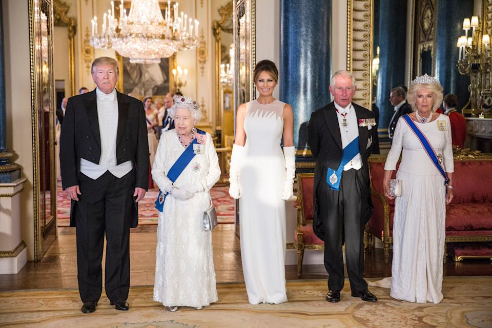 RETRANSMITTED CORRECTING BYLINE (left to right) US President Donald Trump, Queen Elizabeth II, Melania Trump, the Prince of Wales and the Duchess of Cornwall, during a group photo ahead of the State Banquet at Buckingham Palace, London, on day one of US President Donald Trump's three day state visit to the UK.