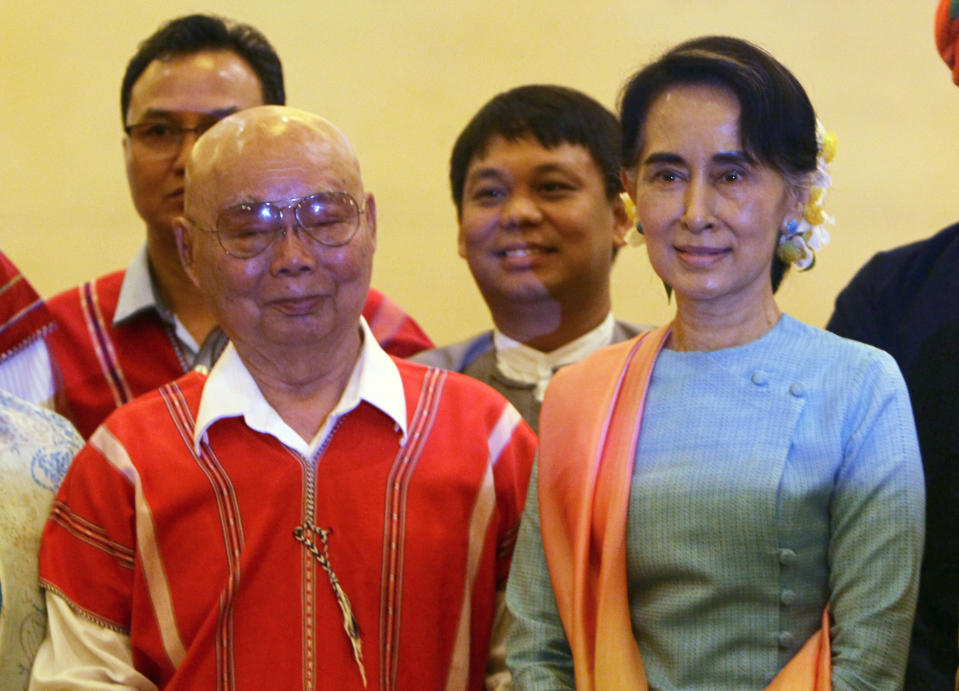 FILE - In this Aug. 24, 2016, file photo, then Myanmar's Foreign Minister Aung San Suu Kyi, right, and Mutu Say Po, chairman of Karen National Union (KNU) pose for photos during their meeting at a hotel in Naypyitaw, Myanmar days before a peace conference that seeks to end decades of armed conflict with ethnic minority groups. The future of the Myanmar's already-fragile peace process between the military, ethnic armed groups and militias is in question as the military regains control of the country after Feb. 1, 2021 coup. (AP Photo/Aung Shine Oo, File)