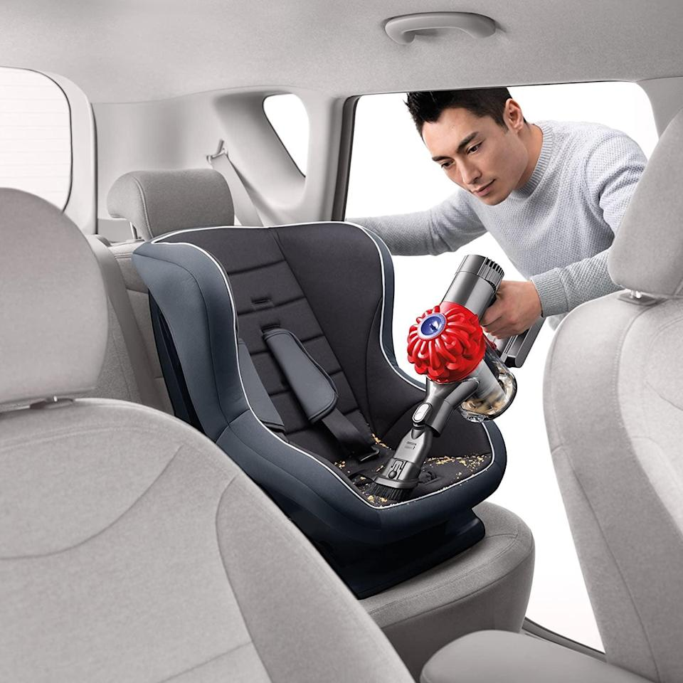 <p>Liquid spills happen, and for the dads who are protective of their cars, they can feel particularly painful. Don't let Dad - or his first baby, the car - suffer from messes with <span>Dyson's V6 Car and Boat Cordless Handheld Vacuum</span> ($360). </p>