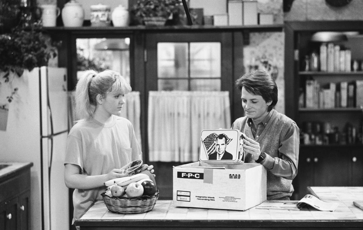 """FAMILY TIES -- """"Paper Chase"""" Episode 24 -- Aired 5/8/86 -- Pictured: (l-r) Tina Yothers as Jennifer Keaton, Michael J. Fox as Alex P. Keaton -- Photo by: NBCU Photo Bank  **FOR EDITORIAL USE ONLY AND CANNOT BE ALTERED, ARCHIVED OR RESOLD. NO TABLOID USAGE WORLDWIDE. SPECIFIC CLEARANCE REQUIRED FOR COMMERCIAL OR PROMOTIONAL USE. CONTACT YOUR NBCU REPRESENTATIVE FOR FURTHER INFORMATION**"""