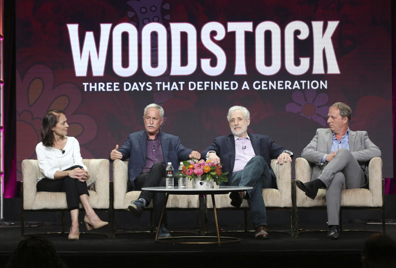 """Senior producer Susan Bellows, from left, author Joel Makower, Joel Rosenman, co-producer of the 1969 Woodstock festival, and director/writer/producer Barak Goodman participate in PBS's """"Woodstock"""" panel at the Television Critics Association Summer Press Tour on Tuesday, July 30, 2019, in Beverly Hills, Calif. (Photo by Willy Sanjuan/Invision/AP)"""