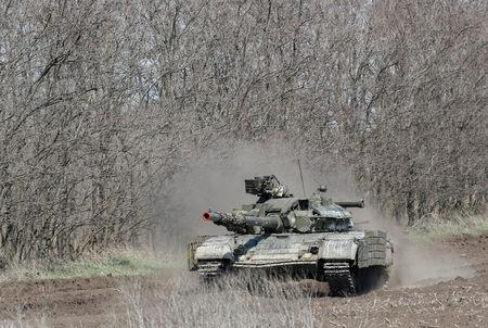 FILE PHOTO: A Ukrainian tank drives in Donetsk Region, Ukraine April 9, 2019. REUTERS/Gleb Garanich/File Photo