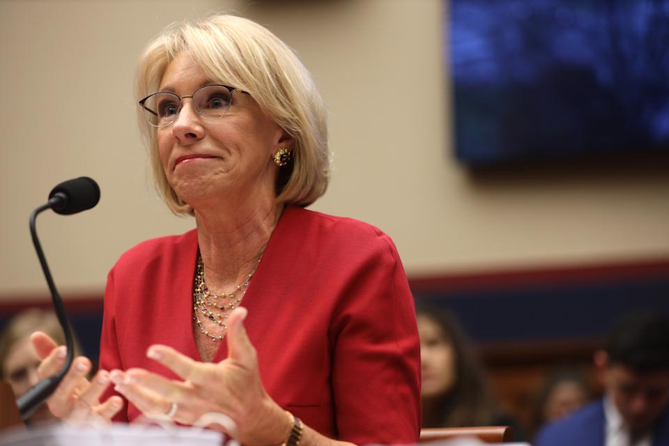 """WASHINGTON, DC - DECEMBER 12:  U.S. Secretary of Education Betsy DeVos testifies during a hearing before House Education and Labor Committee December 12, 2019 on Capitol Hill in Washington, DC. The committee held a hearing on """"Examining the Education Department's Implementation of Borrower Defense.""""  (Photo by Alex Wong/Getty Images)"""