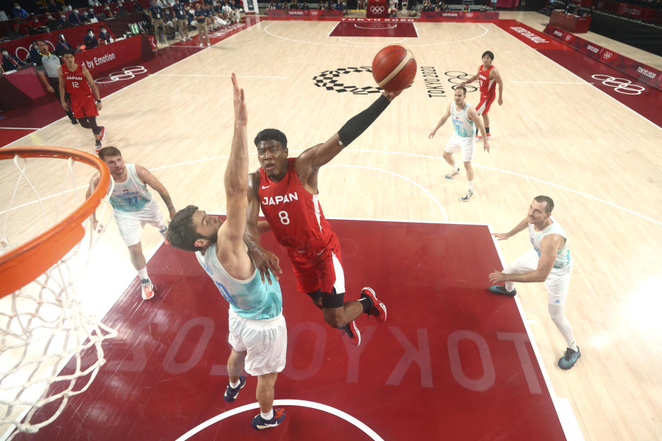 Japan' Rui Hachimura (8) drives to the basket against Slovenia's Mike Tobey (10) during a men's basketball preliminary round game at the 2020 Summer Olympics, Sunday, July 25, 2021, in Saitama, Japan. (Gregory Shamus/Pool Photo via AP)