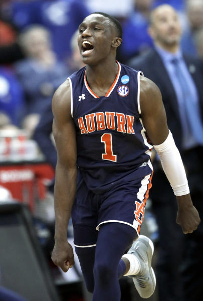 Auburn's Jared Harper celebrates after Auburn defeated Kentucky in the Midwest Regional final game in the NCAA men's college basketball tournament Sunday, March 31, 2019, in Kansas City, Mo. Auburn won 77-71 in overtime. (AP Photo/Orlin Wagner)