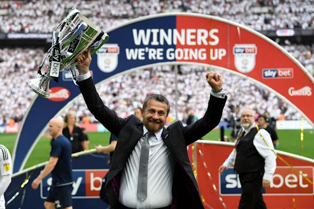 "Soccer Football - Championship Play-Off Final - Fulham vs Aston Villa - Wembley Stadium, London, Britain - May 26, 2018 Fulham manager Slavisa Jokanovic celebrates promotion to the Premier League with the trophy Action Images via Reuters/Tony O'Brien EDITORIAL USE ONLY. No use with unauthorized audio, video, data, fixture lists, club/league logos or ""live"" services. Online in-match use limited to 75 images, no video emulation. No use in betting, games or single club/league/player publications. Please contact your account representative for further details."
