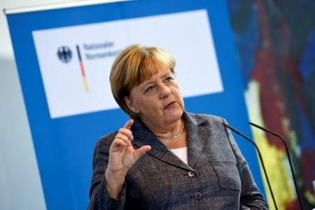 German Chancellor Merkel speaks during a meeting with the National Regulatory Control Council at the Chancellery in Berlin
