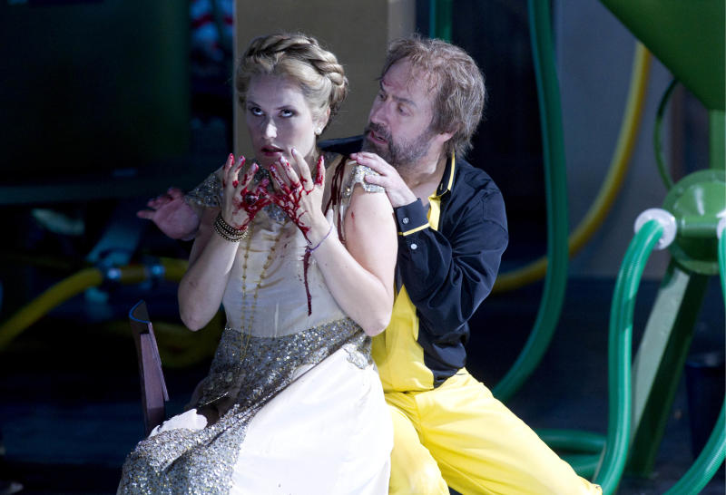 "In this picture taken July 15, 2011,  opera singers Lars Clevemann in the role of Tannhaeuser und Camilla Nylund in the role of Elisabeth, left, perform during a rehearsal of the Richard Wagner opera ""Tannhaeuser"" at  the annual opera festival in Bayreuth, southern Germany. (AP Photo/dapd, Timm Schamberger)  EDITORIAL USE ONLY- TO BE USED ONLY UNTIL SEPT. 30 2011 - NO ARCHIVE NO SALES -"