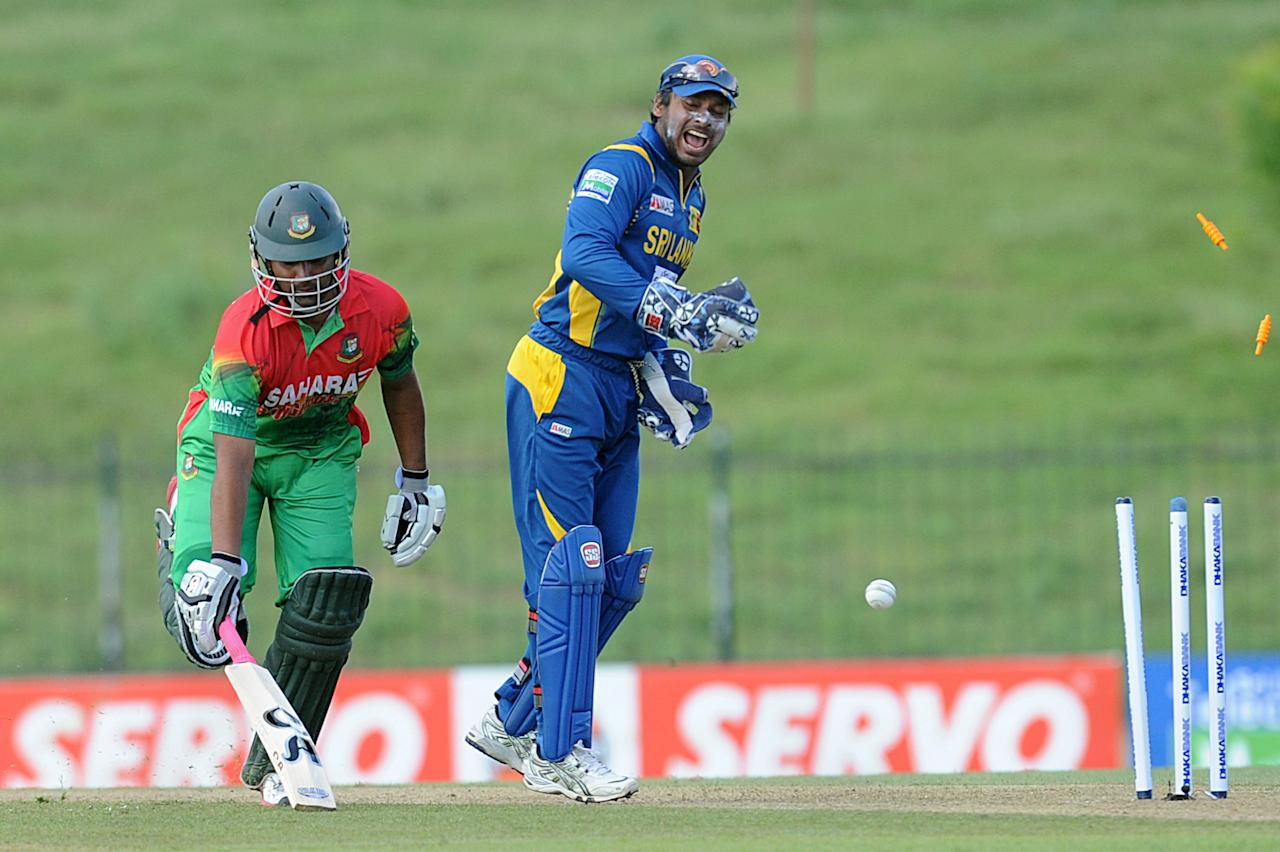 Bangladeshi cricketer Tamim Iqbal (L) avoids a run out as wicketkeeper Kumar Sangakkara looks on during the opening one-day international (ODI) match between Sri Lanka and Bangladesh at The Suriyawewa Mahinda Rajapakse International Cricket Stadium in the southern district of Hambantota on March 23, 2013. Sri Lankan cricket captain Angelo Mathews won the toss and elected to field. AFP PHOTO/ Ishara S. KODIKARA (Photo credit should read Ishara S.KODIKARA/AFP/Getty Images)
