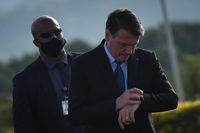 Brazil's president Jair Bolsonaro arrives for the National Flag Raising ceremony in front of Alvorada Palace amid the Coronavirus (COVID-19) pandemic, in Brasilia, Brazil, on Tuesday, June 9, 2020. (Photo by Andre Borges/NurPhoto via Getty Images)
