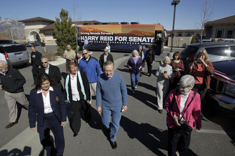 FILE - In this April 6, 2010 file photo, Senate Majority Leader Harry Reid, D-Nev, campaigns in Minden, Nev. A Democratic leader in rural Nevada says she's tired of presidential candidates saying it's too costly and time-consuming to visit far-flung towns. Kimi Cole of the Rural Nevada Democratic Caucus, who lives in Minden, tells The Associated Press that she and others are setting up a series of virtual visits with the Democrats running for president. The online video conferences they hope to launch within a month could be a nationwide model. (AP Photo/Marcio Jose Sanchez, File)