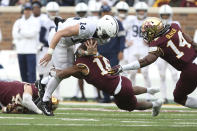 Penn State quarterback Sean Clifford (14) is tackled by Minnesota defensive back Coney Durr (16) during an NCAA college football game, Saturday, Nov. 9, 2019, in Minneapolis. (AP Photo/Stacy Bengs)