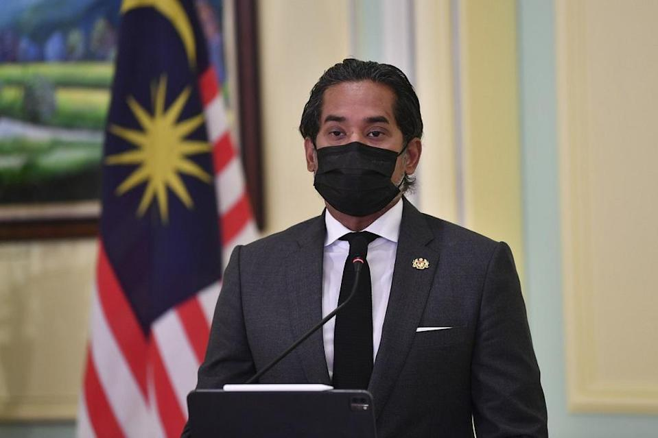 Innovation, Science, And Technology Minister Khairy Jamaluddin delivers his speech during the launch of the National Covid-19 Immunisation Programme Handbook at the Perdana Putra Building in Putrajaya February 16, 2021. — Bernama pic