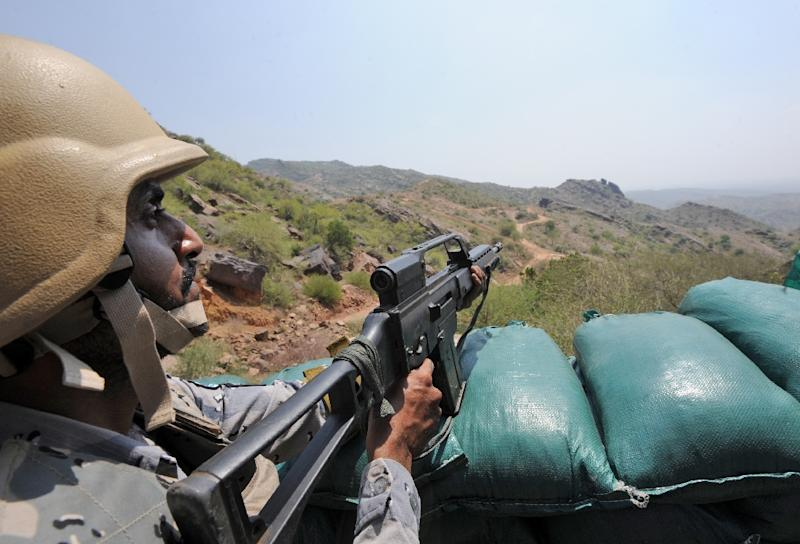 Saudi border guards keep watch along the border with Yemen in the southern Jizan province in 2017