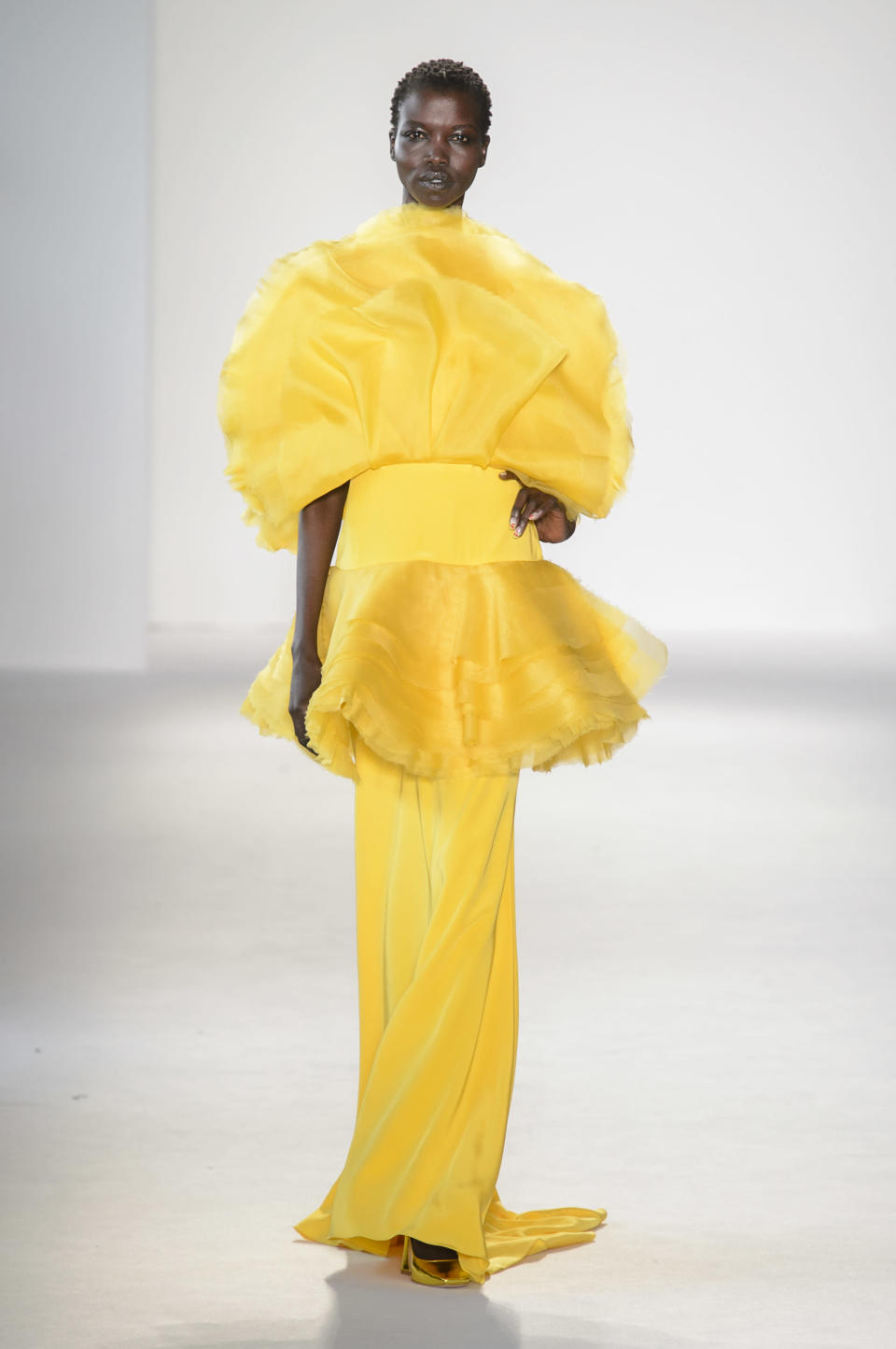 <p><i>Model Alek Wek wears an exaggerated bright yellow dress from the SS18 Christian Siriano collection. (Photo: ImaxTree) </i></p>